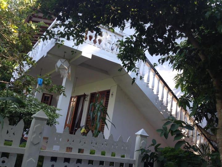 Thilak House