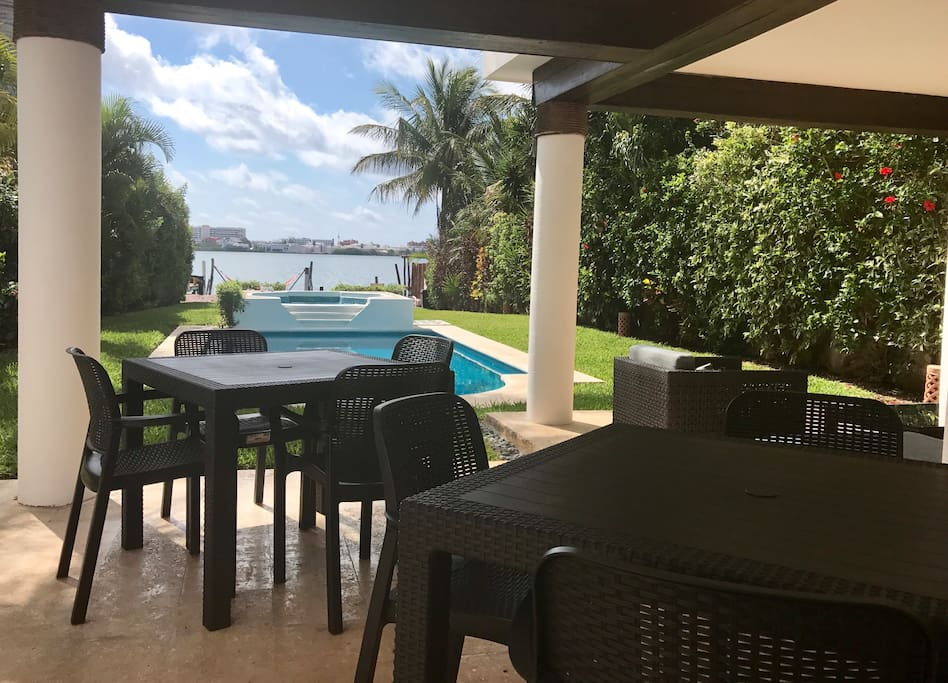 Dining on the terrace with view of the pool and Lagoon