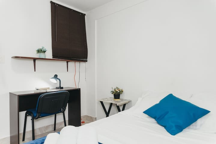 Your private bedroom with double bed, desk/workspace, closet, lamp, night stand.