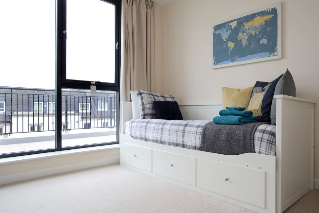 This is the room you will be staying at. It's bright, spacious and the daybed can be doubled for your comfort.