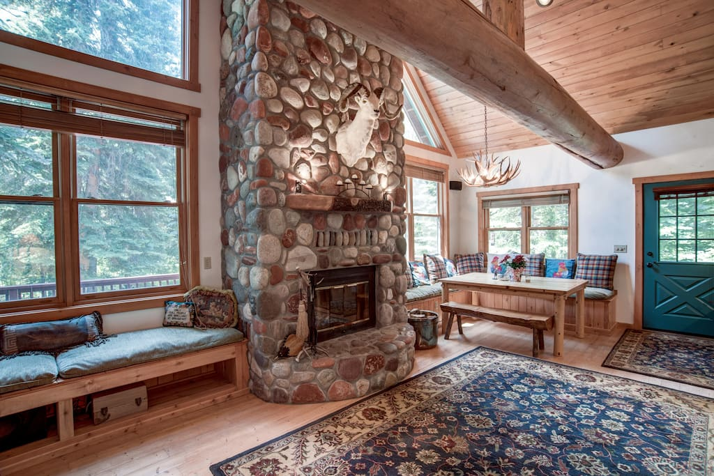 Great room with river rock fireplace and dining nook