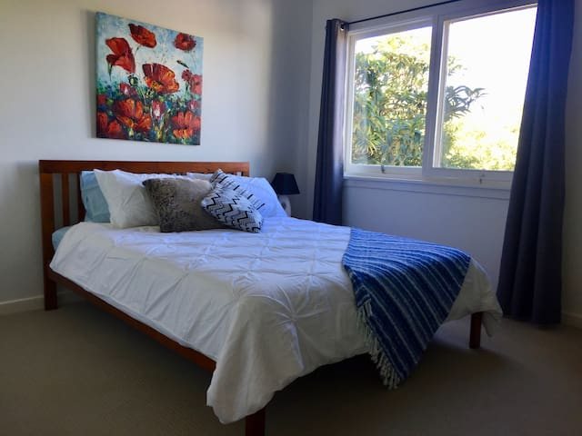 Cosy queen size bed with a view over backyard.