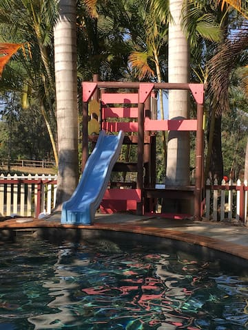 Resort style pool with awesome slide for the kids (and kids at heart!)