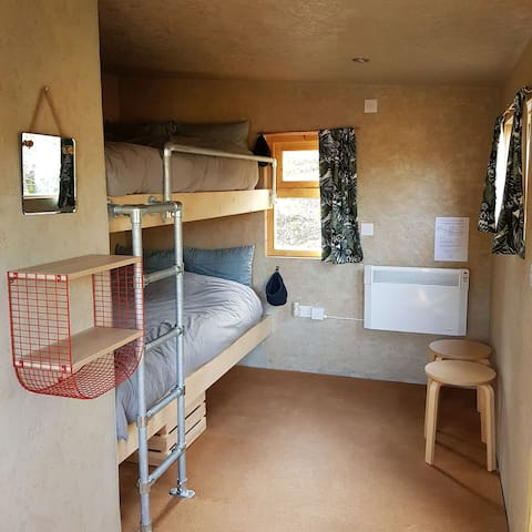 Comfy 4ft (small double) bunk beds with bedding*. The beds are perfect for two and spacious for one. *For the safety of guests and staff we are currently only providing base sheets and mattress protectors