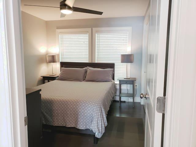 """Bedroom 1 of 2 with queen memory foam bed and 40"""" smart TV"""