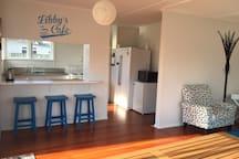 Open plan kitchen/lounge. Double fridge/freezer a small beer fridge and a washing machine