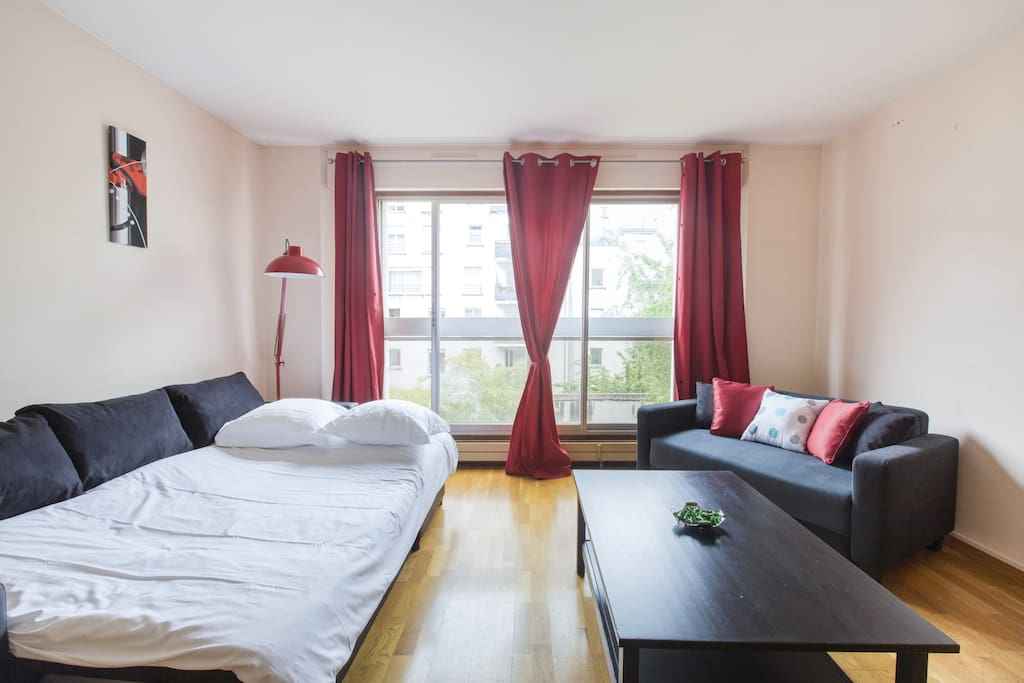 Spacious and bright living room with flat screen TV. Open sofa bed for 2 guests.