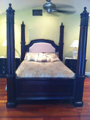 Queen size 4 post bed.