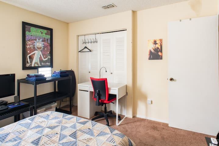 View of guest room with laptop friendly workspace, spot to hang your clothes, and where you can expect to find towels.