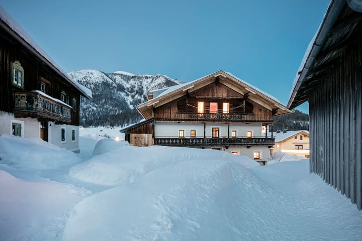 """The """"Retro-Chalet"""" is located in the front of the main-building (in the back and roof area of building, the former barn,  there is a """"CAMP""""   for up to 27 persons; the two houses around are vacant thus offering a beautiful coulisse)"""