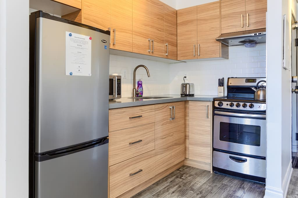 Kitchen with stainless steele appliances and all necessities to make your stay comfortable.