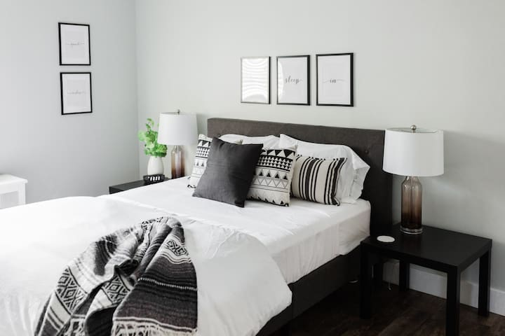 The large bedroom offers guests a queen size bed and multiple pillows with different levels of firmness