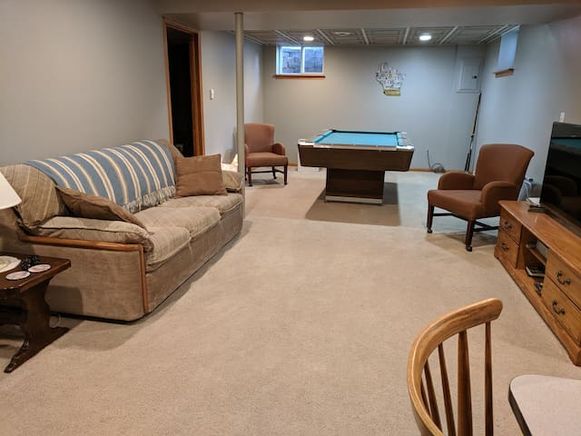 Living area with queen sofa sleeper, pool table, TV w/Fire Stick & HDMI cable
