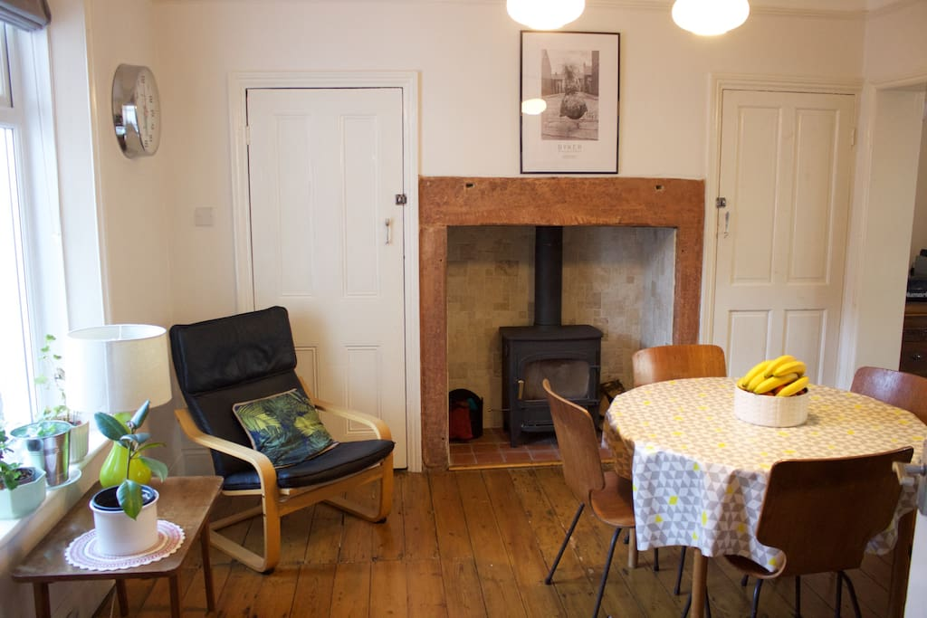 Open plan dining room with log burning stove and extendable dining table to sit up to 6 people.