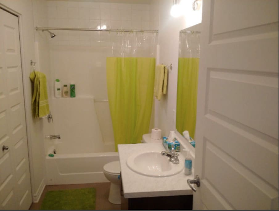 Bathroom with good size tub and washing machine in closet