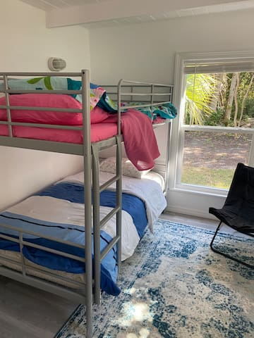 Kids room with bunk beds, dresser and closet