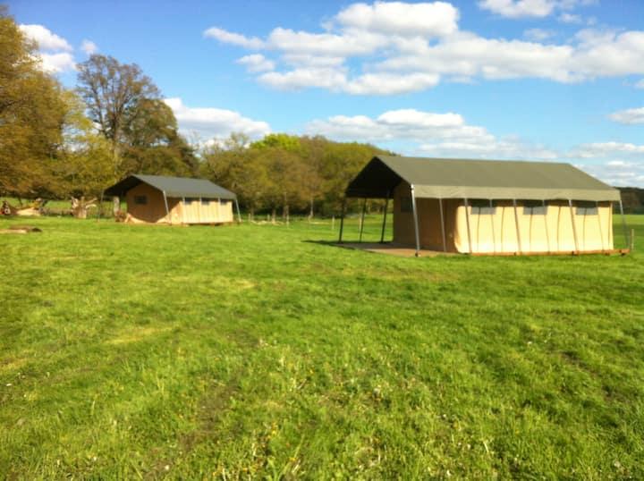 A safari tent on a beautiful farm
