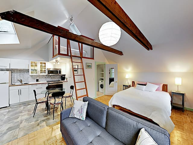 Located upstairs, Unit 1 offers a plush queen bed, a contemporary kitchen, and a loft.
