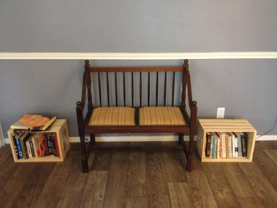 antique bench with silk lace cushion w/ mystery & art books..etc.