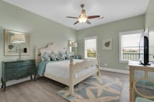 Soothing and subtle 3rd floor king bedroom with flat screen and hand-painted estate furnishings.