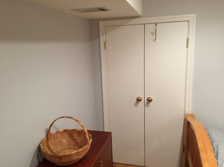 Dresser and closet in bedroom
