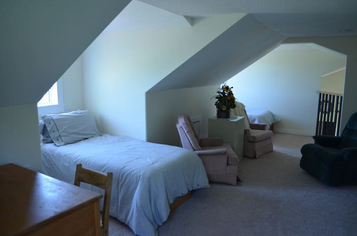Bedroom 2 - Loft area with 2 single beds, desk and 3 rocking chairs.