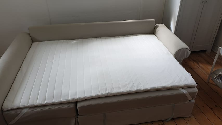Place the bed mattress evenly on top
