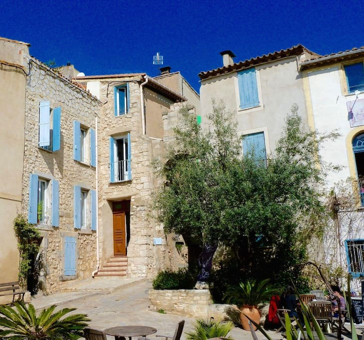 Our home: No 1 Le Place, in the quiet corner of the lovely village square. Bages is located on the water between Narbonne and Collioure