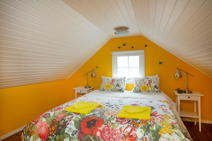 The yellow butterfly room adjoining to the upstairs bathroom