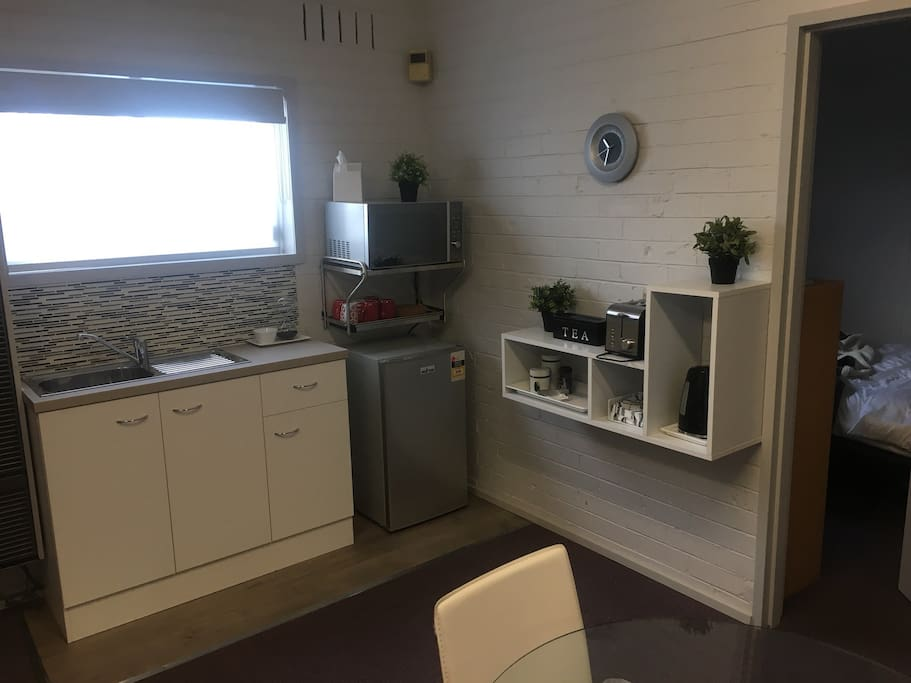 kitchenette with fridge and convection microwave