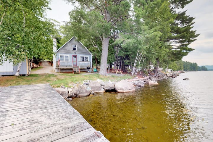 Rustic, lakefront cabin w/ deck, pebble beach, & outdoor firepit - dogs welcome!