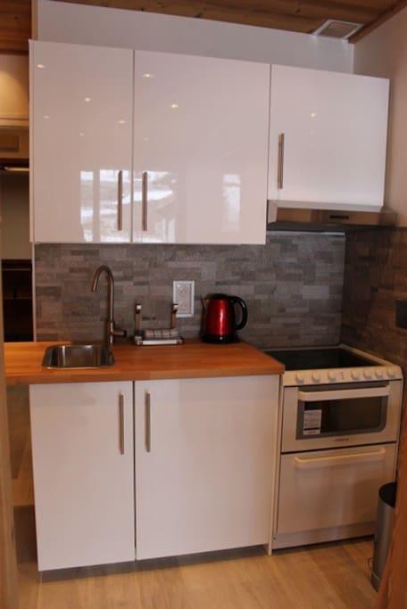 Kitchen - with conventional oven, 4 ringed hob, dishwasher, fridge freezer.