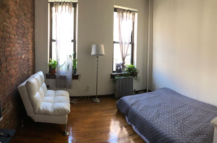 Large studio with tall ceiling near Central Park