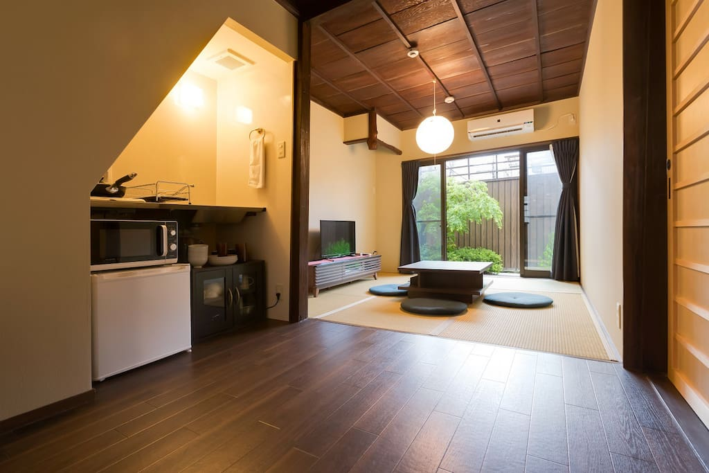 Living room with kitchen. Refrigerator, microwave, induction cooker and so on. You can stay like you live in Kyoto.