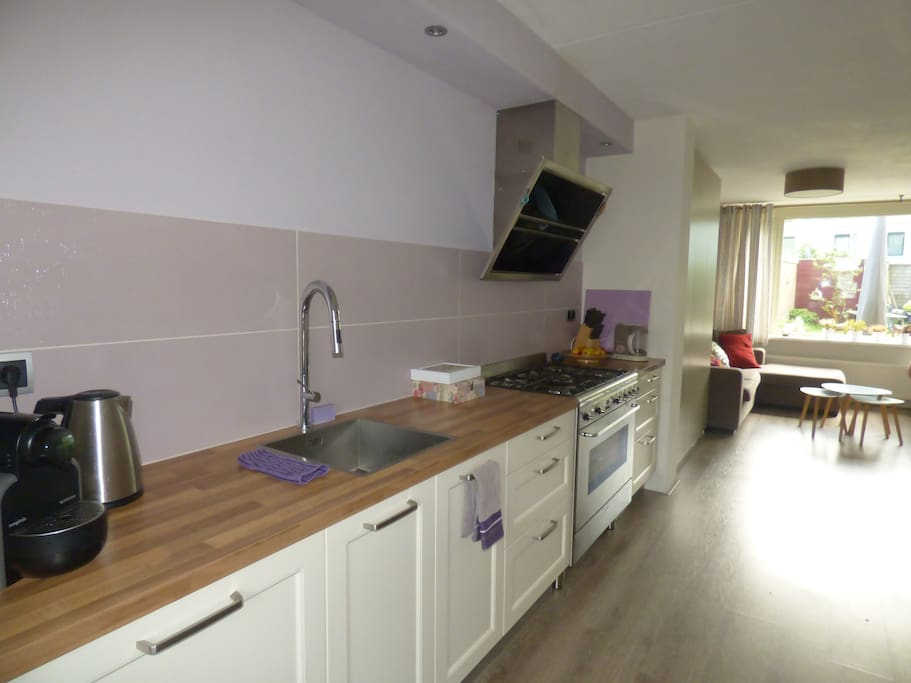 Nice open kitchen with stove, oven & dish washer and lots of prep space