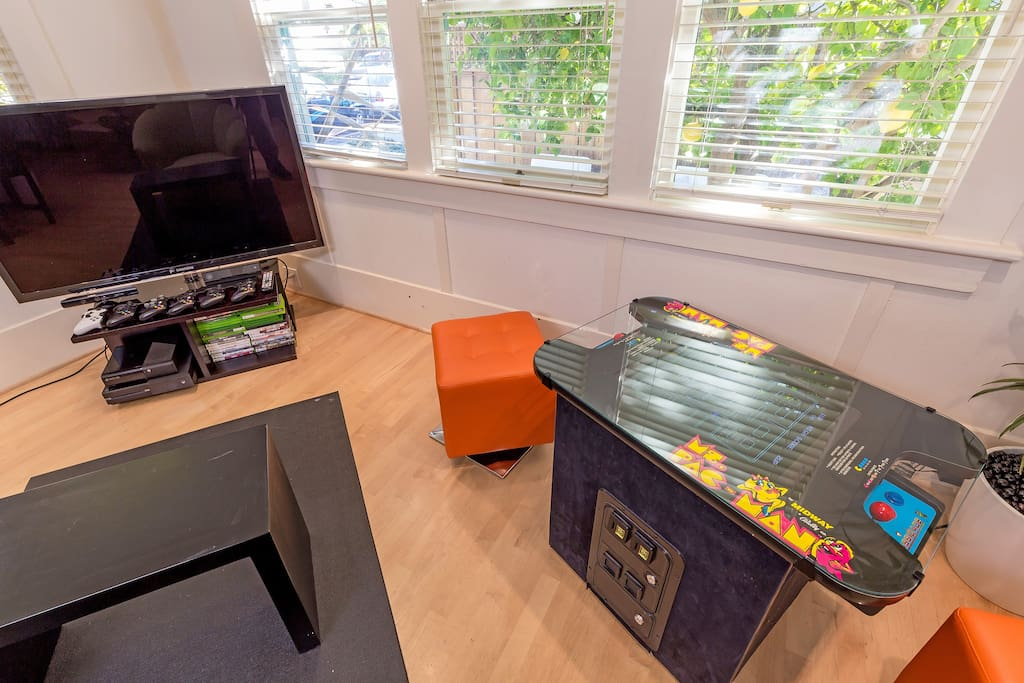 The living room includes a gamer's paradise ... with a full restored vintage gaming console with Ms Pacman