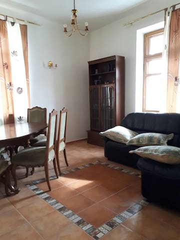 Living room with the balcony behind the sofa. Very cozy place to chill after a long day enjoying Kijiv, it can be used also as a sleeping area.