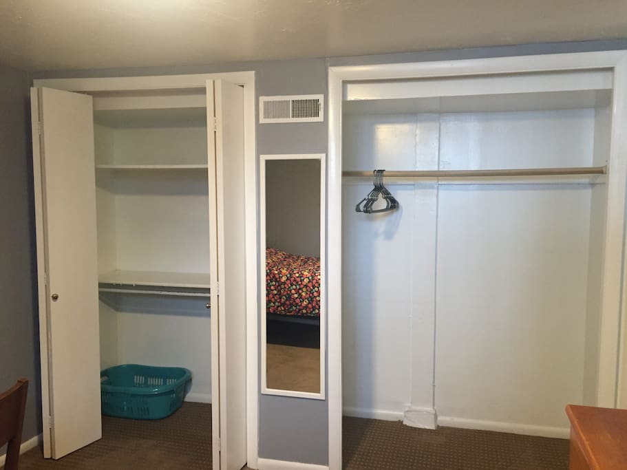Double closet with a mirror in between. Laundry hamper/basket  and a few hangers included.