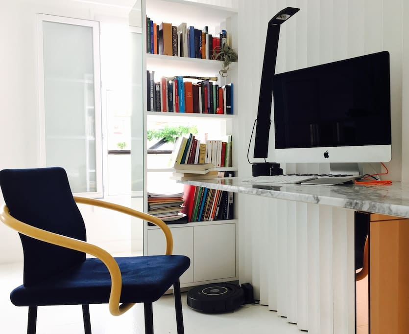 A marble desk, with my iMac and my books at your disposal.
