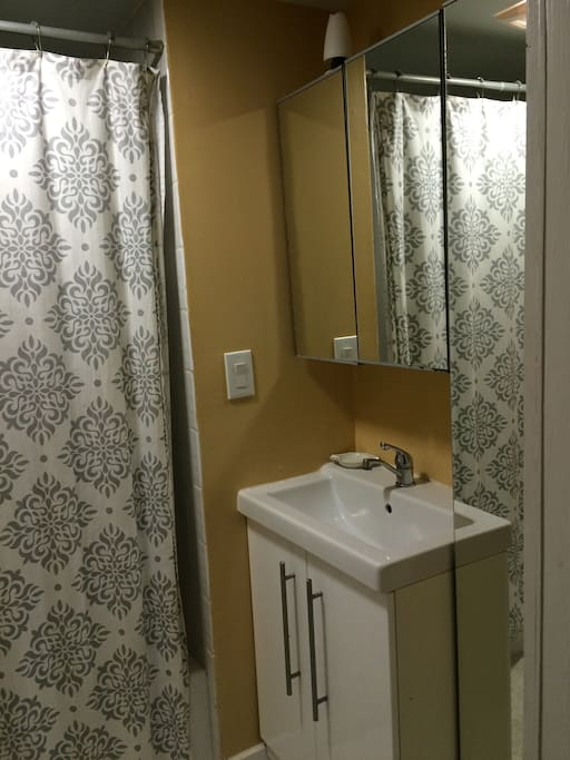 Full bath with tub just around the corner. May be shared with other guests if adjoining room is booked. Lots of storage for long term guests.