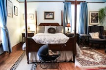 Four poster bed in the main guestroom is only one of the family heirlooms furnishing it.