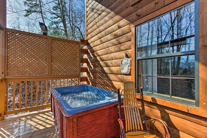 With a private hot tub, fire pit, and deck, this cabin is the perfect escape!
