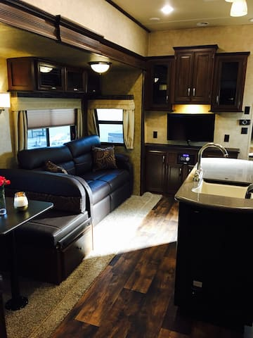 Luxury RV with privacy, pool, hot tub.