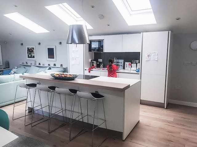 The open plan kitchen and lounge with all the ameneties you could need