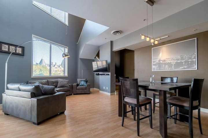 24 Foot Ceiling Executive Loft /w Heated Parking