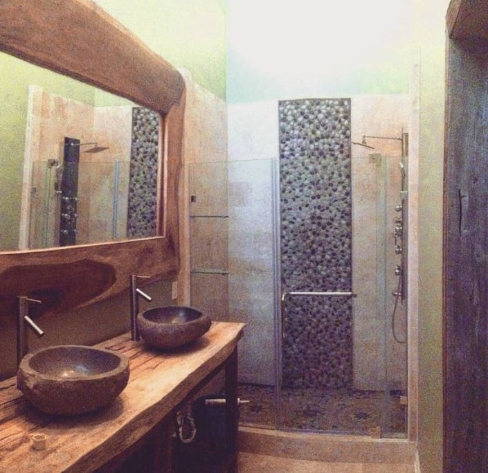 The master bath is spacious, modern, and relaxing.