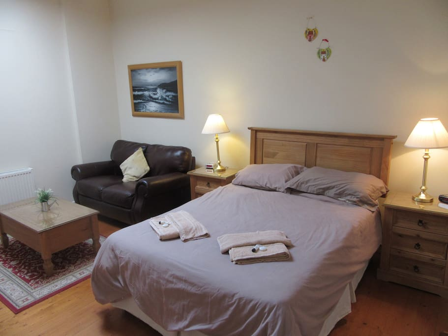 Double bedroom with walk in wardrobe, settee and television and dvd