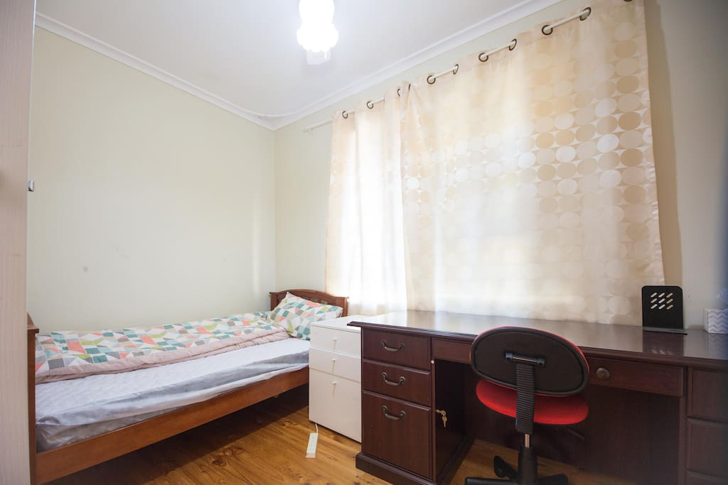 A single bed with working desk in room 2