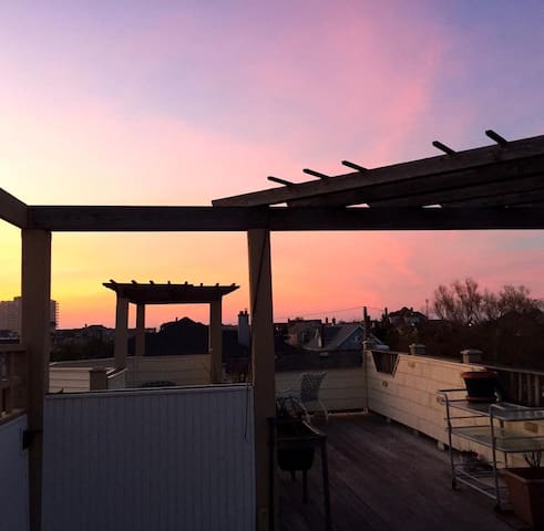 Lotus Blossom Suite and sunset from rooftop deck.