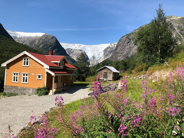 House in Jostedal. View to the glacier.